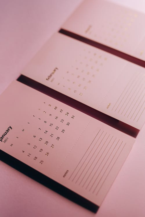 Calendar with inscriptions and numbers on office table