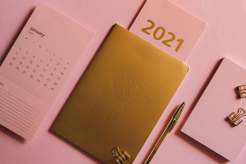 Planner And Calendar On Pick Background