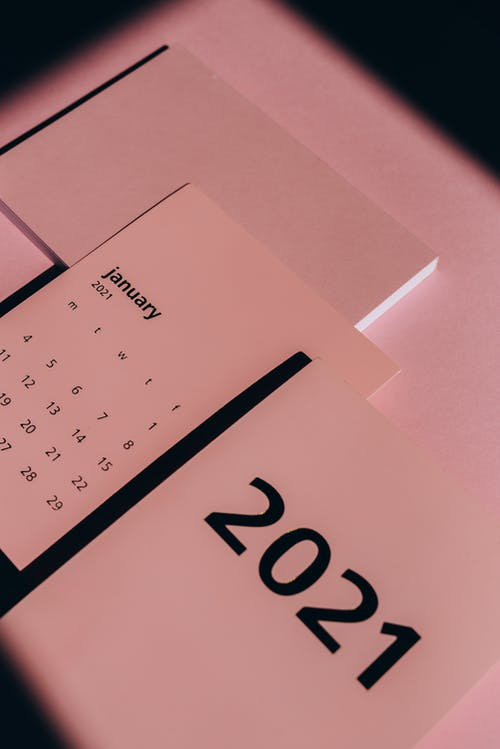 Annual calendar with dates on pink background