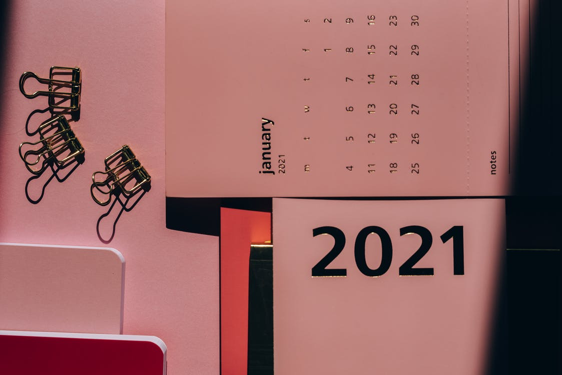 White and Black Calendar on Pink Wall January