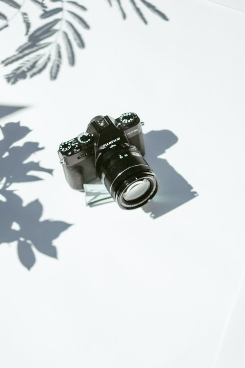 Black Dslr Camera on White Surface
