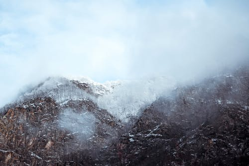 Free stock photo of fog, foggy mountain, snow, winter