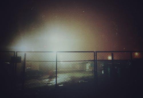 Black Metal Fence during Night Time