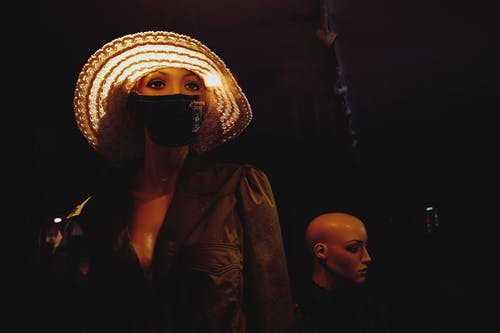 Mannequin in hat and mask in dark warehouse
