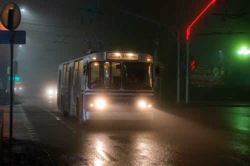 Old trolleybus riding on night street
