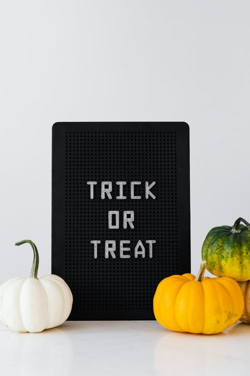 Pumpkins and Trick or Treat Sign