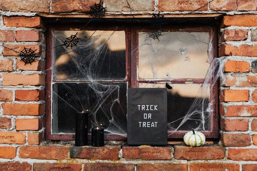 Broken Window With Halloween Decorations