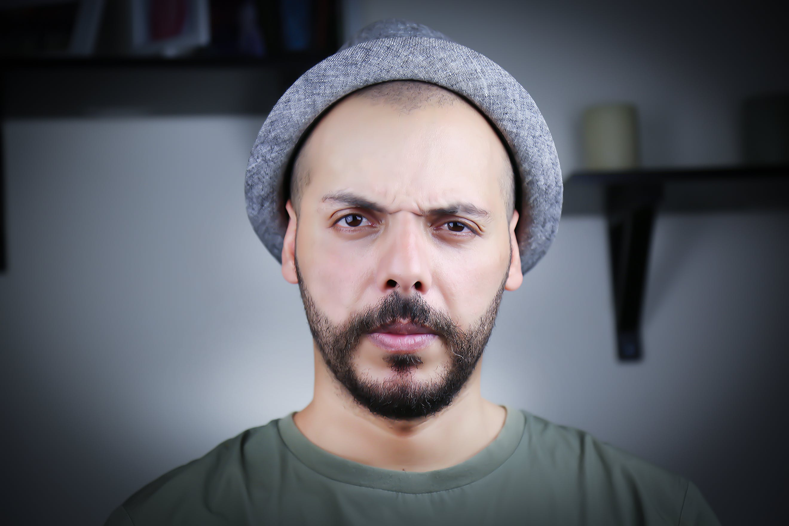 Man Wearing Gray Cap and Crew-neck Top