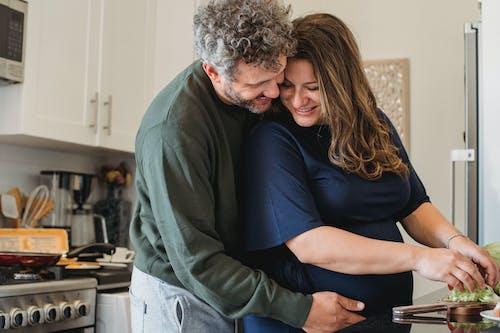 Romantic couple preparing breakfast together