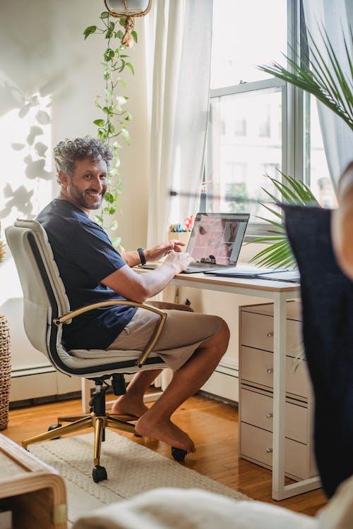 Adult man typing on laptop