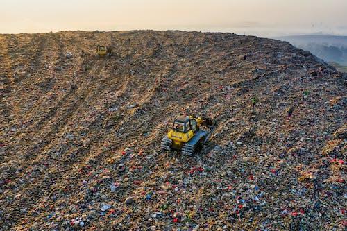 Yellow Heavy Equipment on Landfill