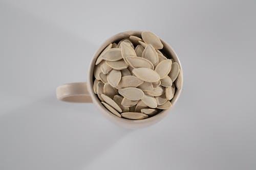 White Ceramic Mug With Brown Coffee Beans