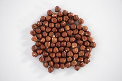 Brown Coffee Beans on White Surface