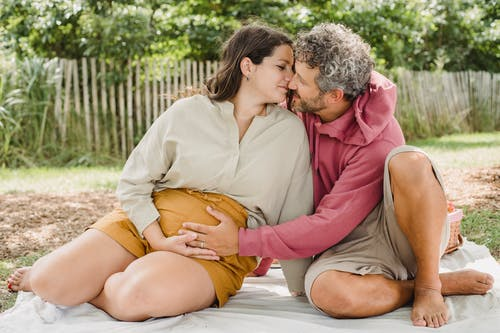Couple having picnic together in backyard