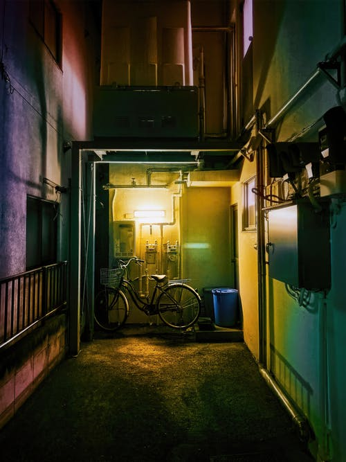 Bicycle Parked in an Alley