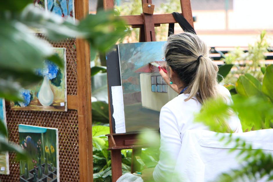 A woman painting in her patio