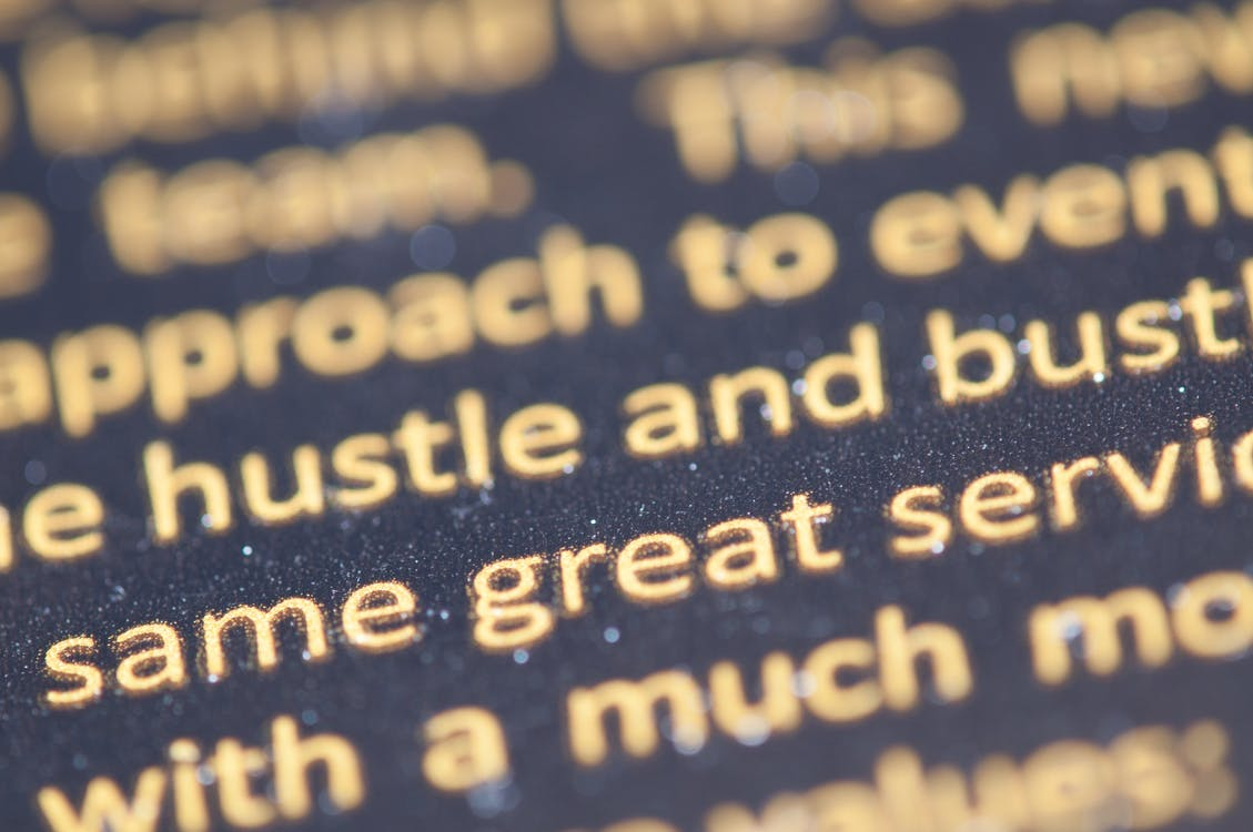 Selective Focus Photography of Hustle and Bust Text