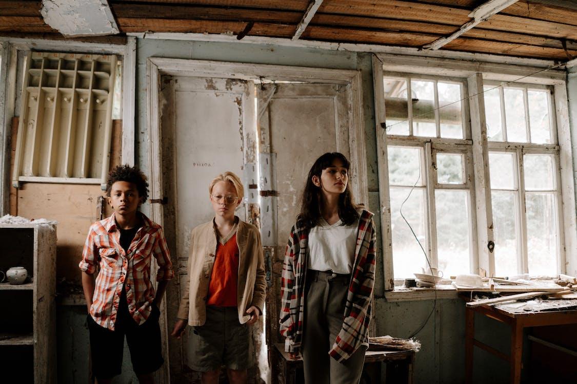 3 Women Standing Beside Window