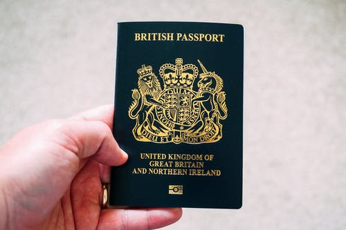 Crop unrecognizable person demonstrating British passport