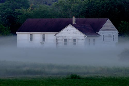 Exterior of a Haunted House Covered with Fog