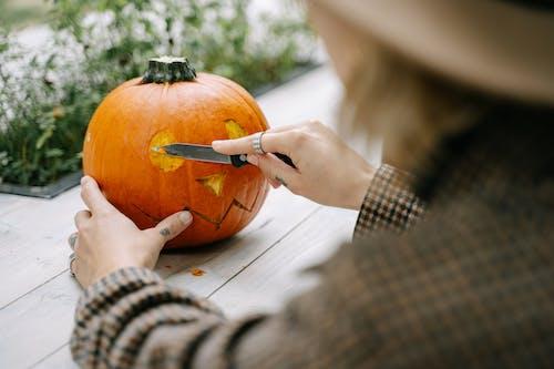 Person Carving a Pumpkin