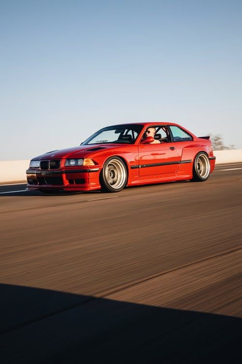 Red Bmw M 3 on Road