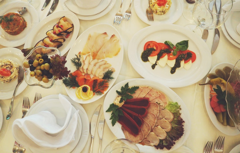 Assorted Dishes Served on White Ceramic Oval Plate on the Table