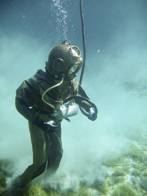 Person in Green Scuba Diving Suit