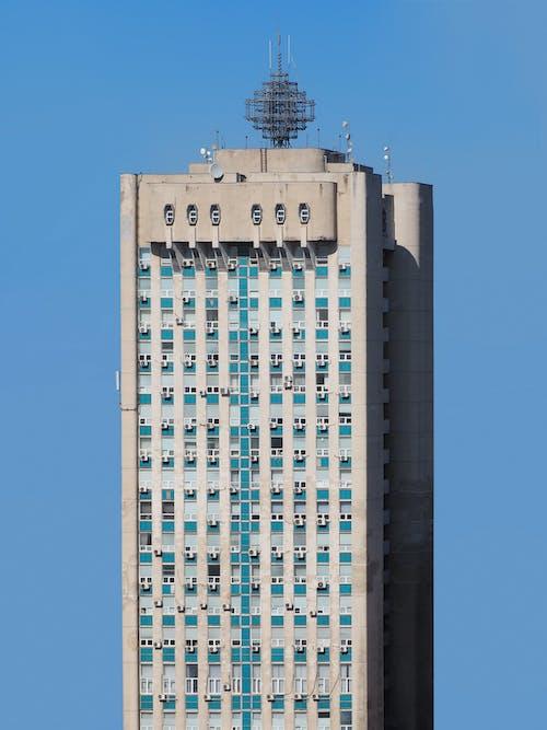 Blue and White Concrete Building Under Blue Sky