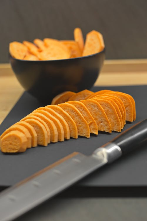 Cut sweet potato on cutting board