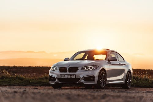 White Bmw M 3 Coupe on Brown Field