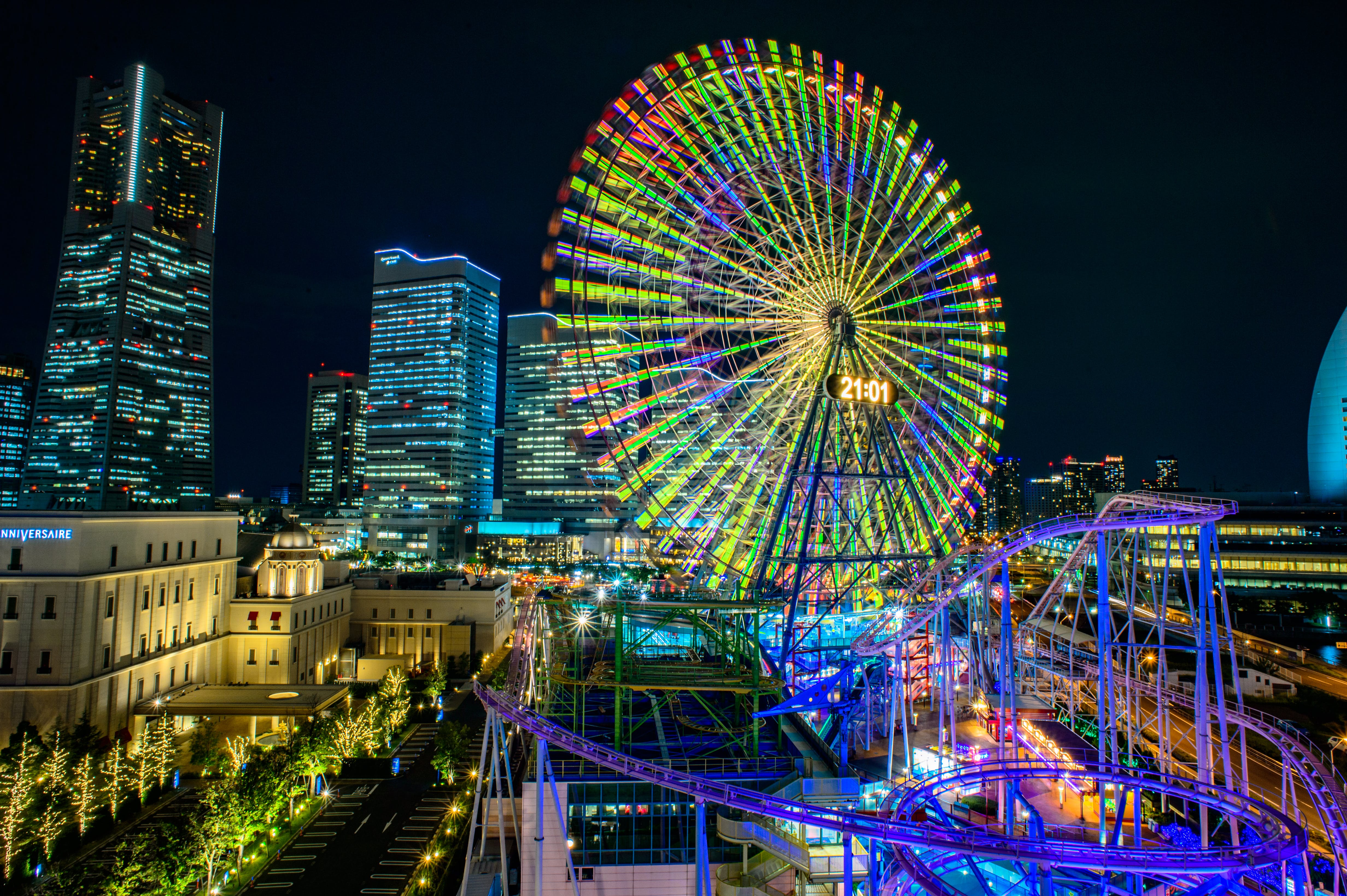 Multicolored Led Lights on Ferris Wheel and Roller Coaster during Nighttime