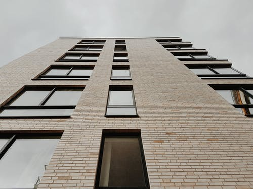 Down View of a White High Rise Concrete Building
