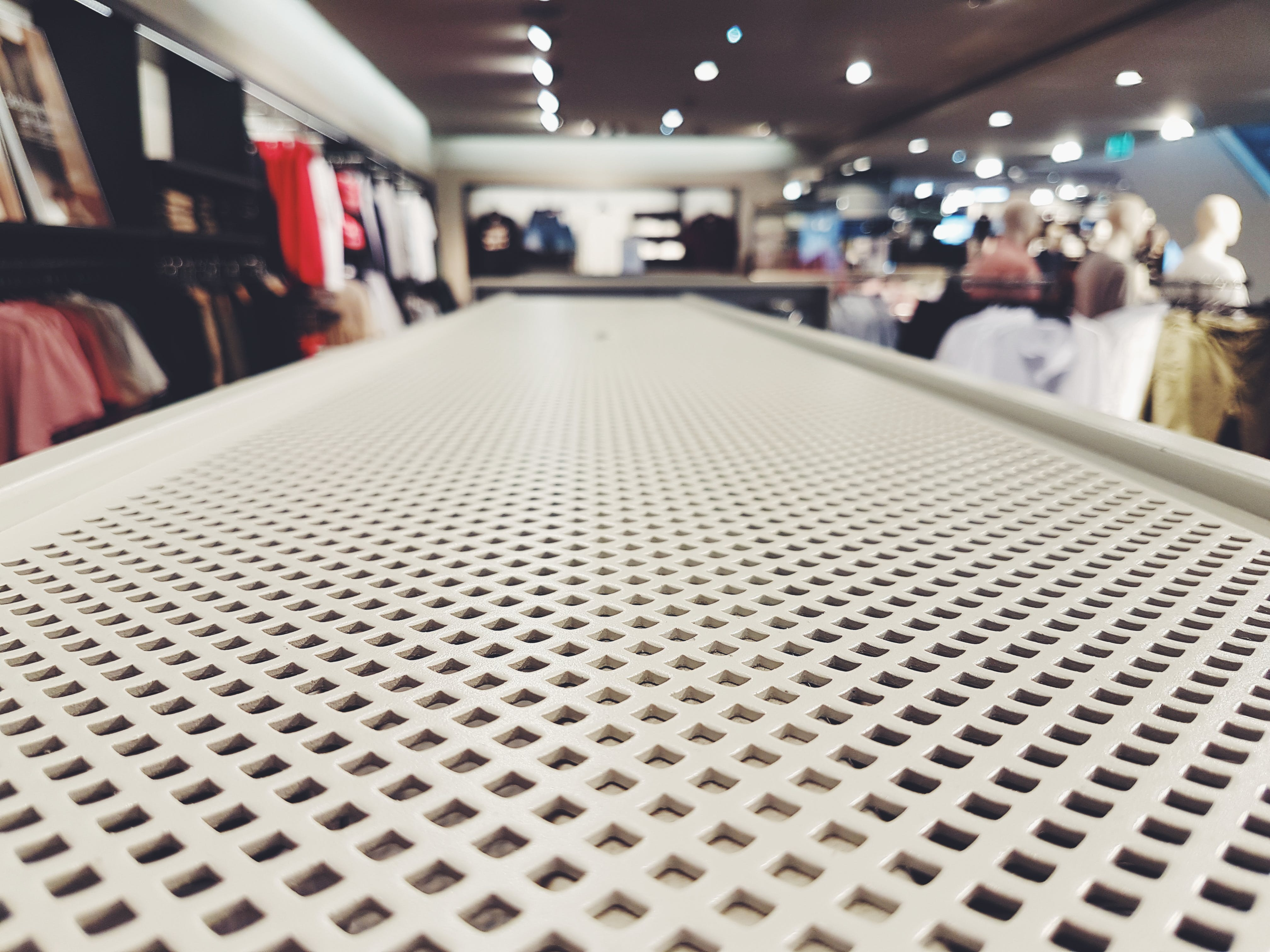 Selective Focus Photography of White Mesh Board