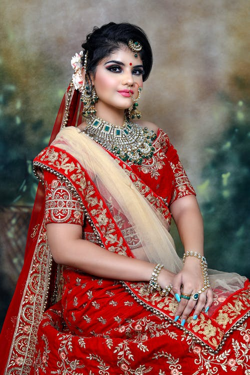 Indian lady in traditional clothes with sari and jewelries