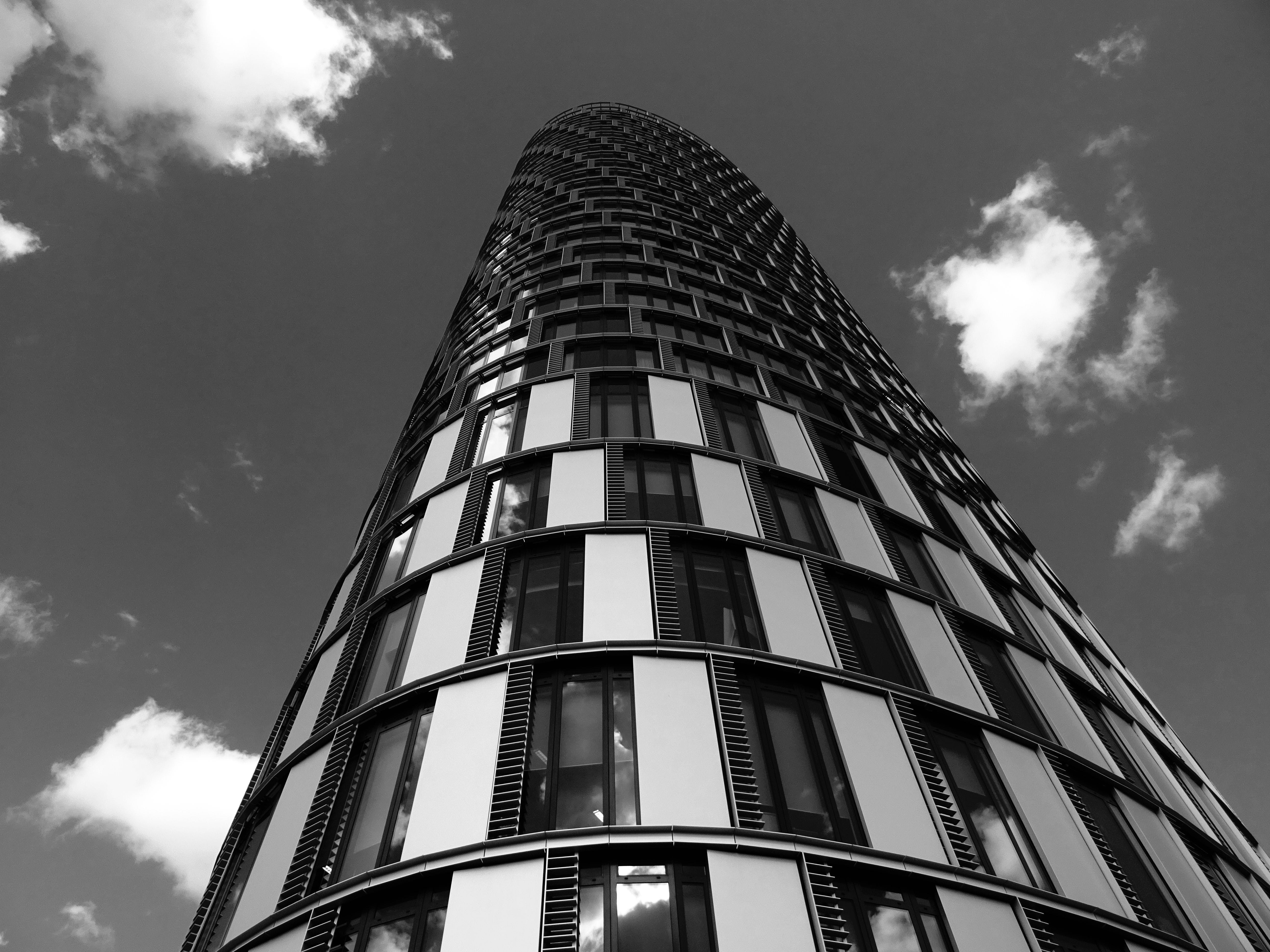 Grayscale of Building Under Sky