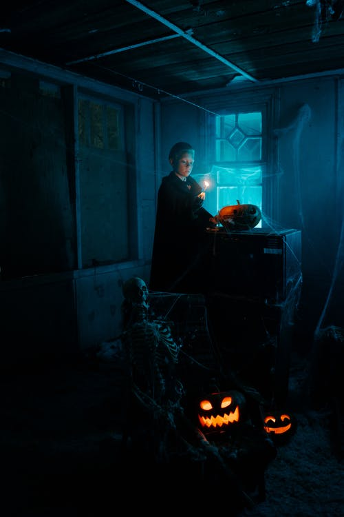 Boy With a Lit Match in a Dark Room