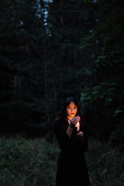 Woman in Black Long Sleeve Shirt Standing in Forest