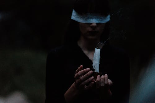 Blindfolded Woman With a Candle