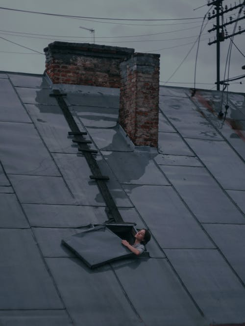Woman on roof in rainy day