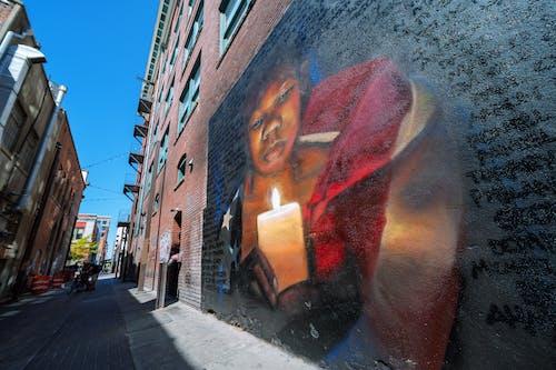 Graffiti on brick wall on street
