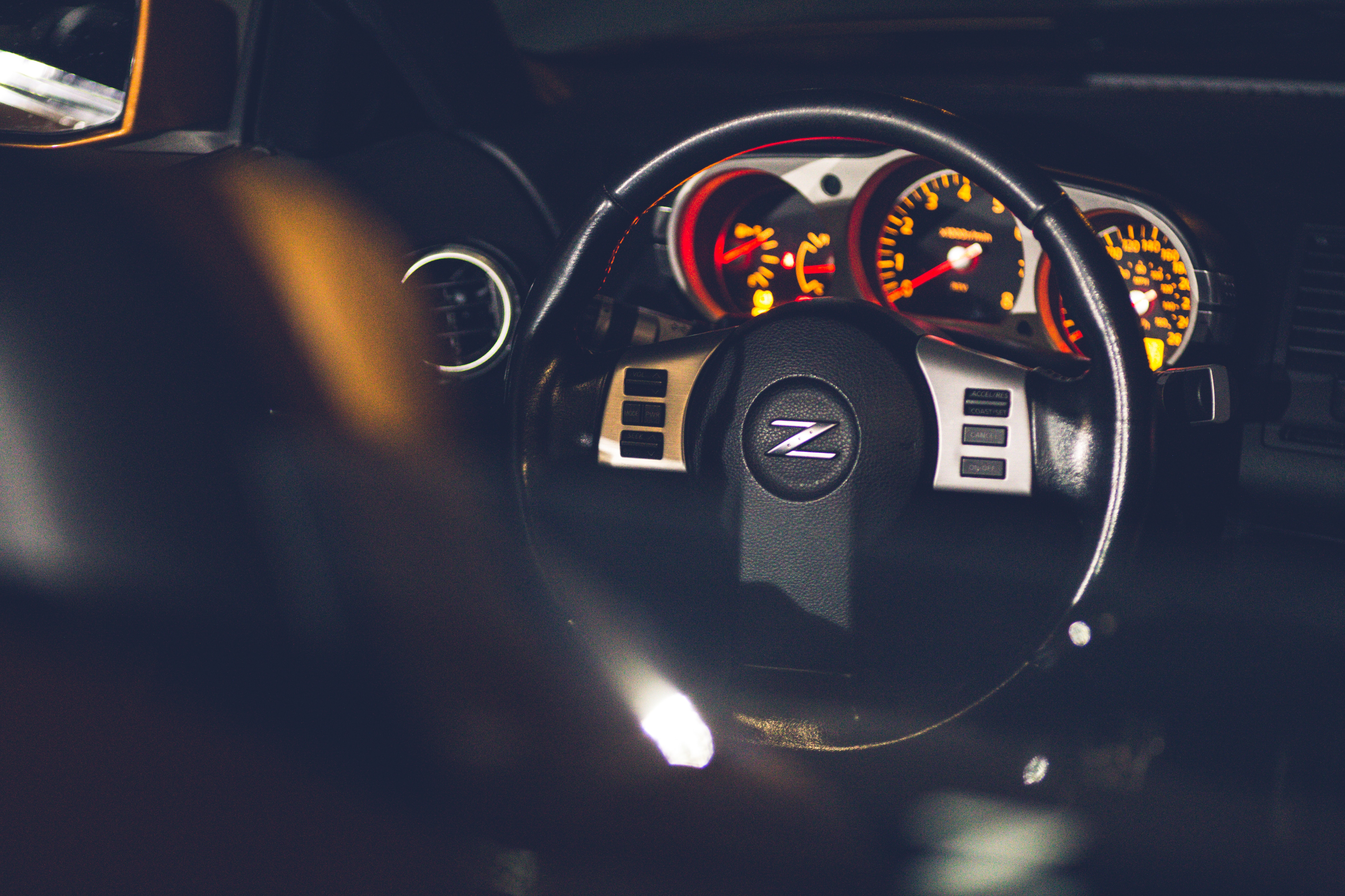 Steering Wheel And Dashboard In Modern Car At Night Free Stock Photo