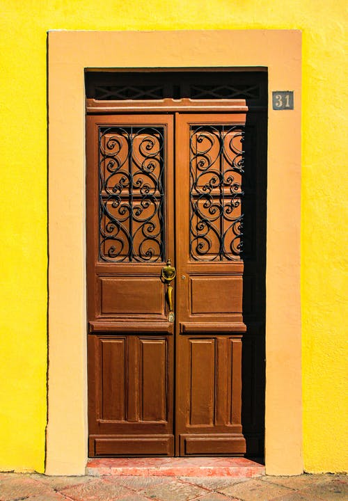 Old yellow residential house with wooden doors