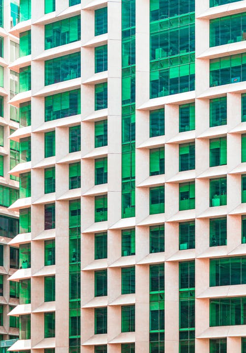 Modern building facade with green glass walls