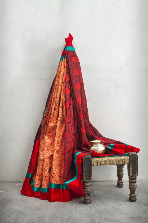 Red Textile on Brown Wooden Armchair