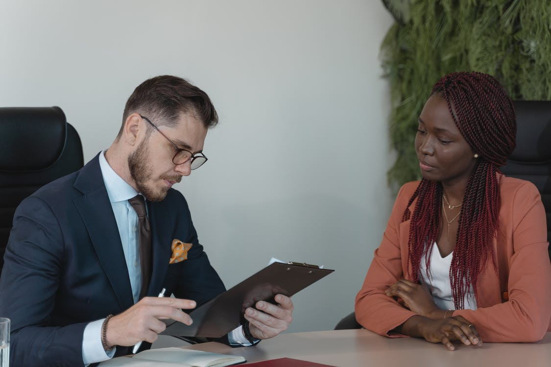 Man Reviewing Woman's Resume