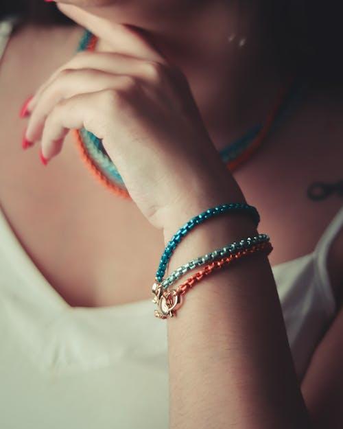 Woman Wearing Blue Beaded Bracelet