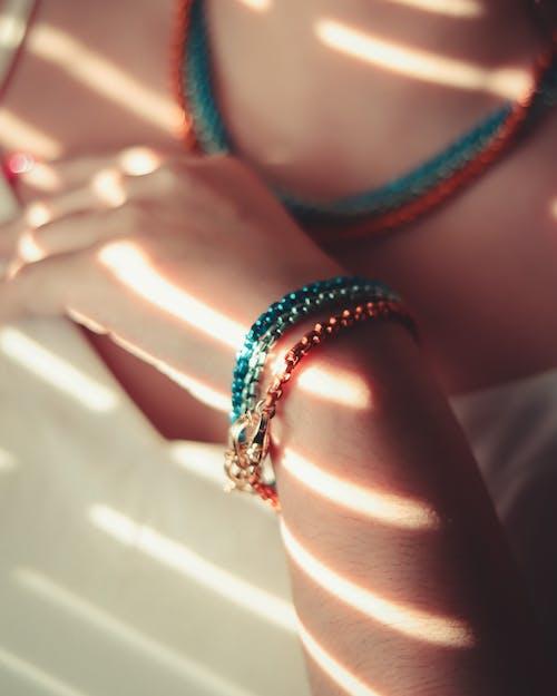 Person Wearing Green Beaded Bracelet