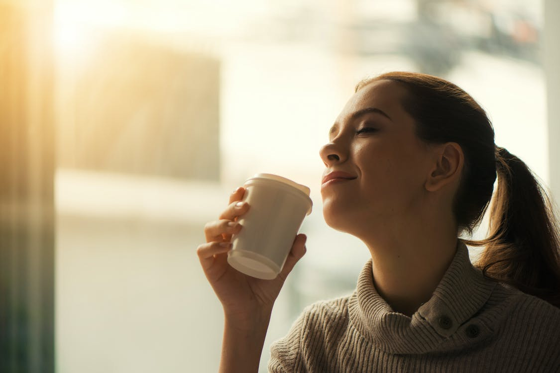 Woman About to Drink from Plastic Cup