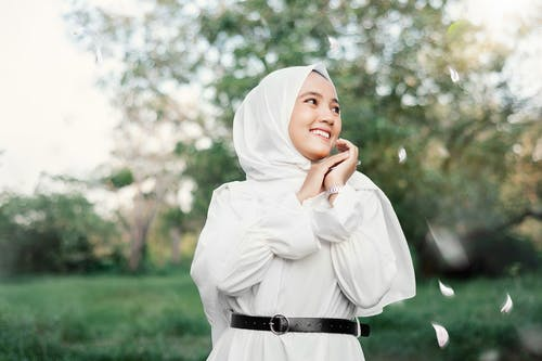 Woman in White Hijab and White Long Sleeve Dress